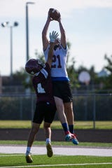 First Baptist Academy's Ty Cavaliere catches a pass during football practice. Cavaliere is one of three seniors on the team and two returning starters on offense.