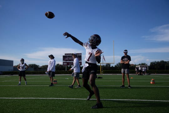 First Baptist Academy quarterback Rich Mellien throws a pass during football practice. The freshman plus sophomore running back Tyler Coleman are expected to step in as playmakers for a depleted offense.