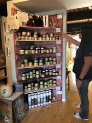 Rica's Bowtique owner Erica Blosser explains the qualities of different Dixie Belle paints. She is a Dixie Belle retailer.