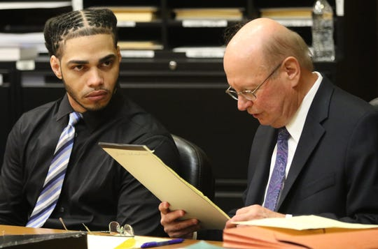 Hendryck Acosta, left, with his attorney, Vincent Basile, at State Superior Court in Paterson. Acosta is on trial for murder and weapons charges. Tuesday, July 30, 2019