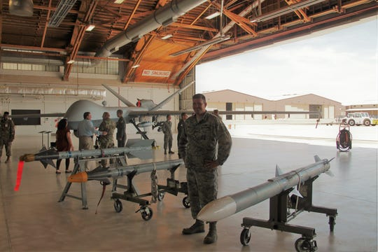 Sgt. Michael Welte and some munitions at the Holloman Air Force Base Civic Leaders Open House July 29.