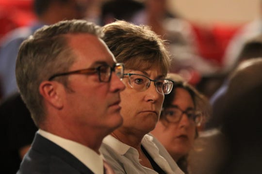 Aztec Mayor Victor Snover and La Plata County Commissioner Gwen Lachelt listen to public comments during a public meeting in July 2019.