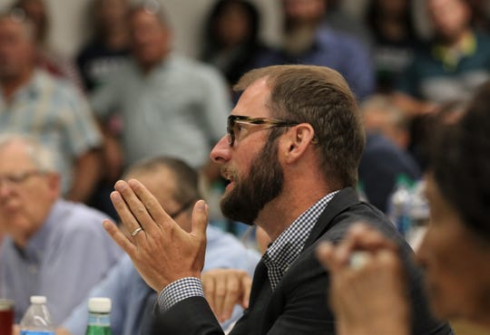 Jon Goldstein asks a question, Monday, July 29, 2019, during a meeting about methane at San Juan College.
