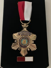 Wayne Police Lt. Kevin Schmidtke recently received a medal for reopening and closing a cold rape case.