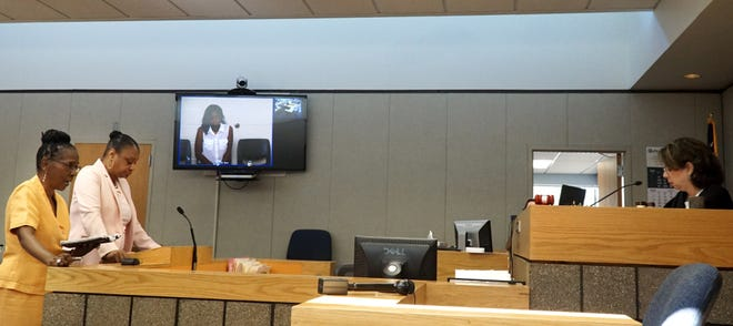 Defense attorneys Sharon Clark Woodside, left, and Lillian Diallo appear before Judge Karen Khalil on July 30 for their clients Michael DeShawn Lewis and Steffani Jones - who appears via video link at center from the Redford jail.