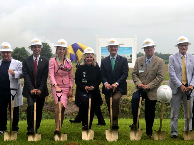 From left: Dr. Warren Degatur, Sen. Fred Mills (R-Breaux Bridge), Louisiana Department of Health Sec. Rebekah Gee, St. Martin Hospital CEO Karen Wyble, Gov. John Bel Edwards, Lafayette General Medical Center CEO Patrick Gandy, and St. Martin Parish President Chester Cedars participate in the groundbreaking ceremony for the St. Martin Hospital expansion Tuesday, July 30.