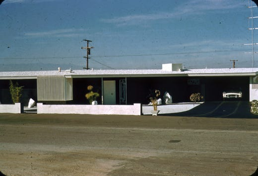 The Boyds had their home on Joshua Tree Street painted black with white trim.