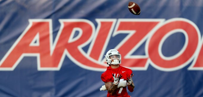 Arizona wide receiver Jaden Mitchell settles under a punt  on opening day of practice for the upcoming season, Tucson, Ariz., July 26, 2019.
