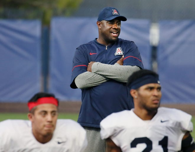 Marcel Yates, defensive coordinator, watches as players execute drills during a practice at Cole and Jeannie Davis Sports Center on July 29, 2019 in Tucson, Ariz.