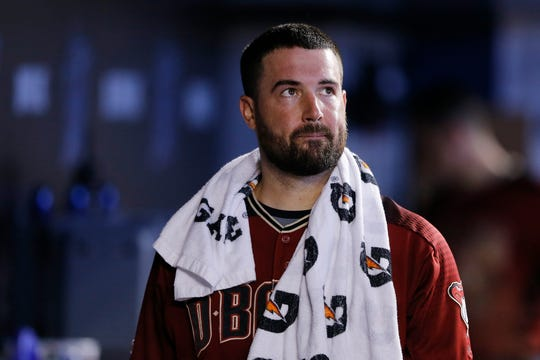 Robbie Ray #38 of the Arizona Diamondbacks looks on in the dugout against the Miami Marlins at Marlins Park on July 28, 2019 in Miami, Florida.