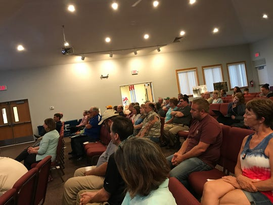 A small crowd of China Township residents attended a special meeting at Crossroads Community Church on Monday, July 29, 2019.