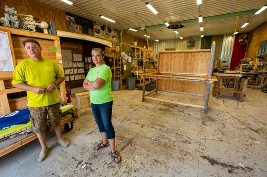 Richie, left, and Jeanne Cunningham talk about some of their projects in the workshop of Tiki Republic Tuesday, July 30, 2019, in Smiths Creek. They have been building Tiki-hut bars for clients in the Blue Water Area and beyond for 13 years professionally and seven years full-time.