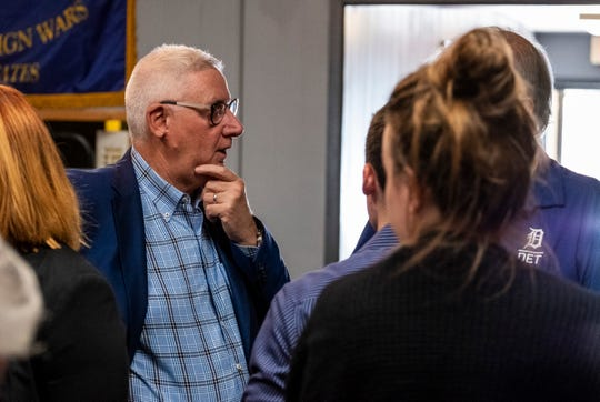 U.S. Rep. Paul Mitchell talks with constituents after a forum regarding two Veterans Affairs' programs held inside VFW Post 796 in Port Huron Tuesday, July 30, 2019. Mitchell said last week that he plans to step down from his seat in Congress after just two terms in early 2021.