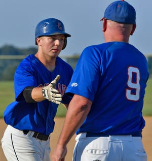 Conrads' Chad Kennell, right, congratulates Ben Bills after Bills hit a homer in a recent game. Bills is enjoying a strong season for Conrads this summer in limited action. John A. Pavoncello photo