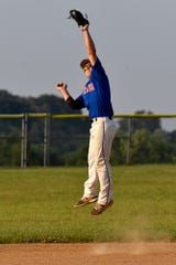Conrads shortstop Ben Bills makes a leaping catch of a line drive against York Township on Monday, July 29.