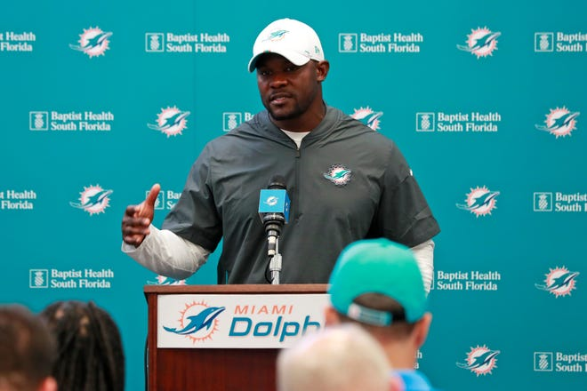 "Miami Dolphins head coach Brian Flores, above, says he went with his ""gut"" when firing Delone Catholic High School graduate Pat Flaherty as the team's offensive line coach."