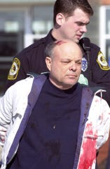 William Michael Stankewicz is removed from the North Hopewell-Winterstown Elementary School after the machete attack in February 2001.
