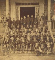 This picture of children on the steps of Wernle orphanage is estimated to be about 1885, three years after today's story took place. – Image courtesy of Indiana Album.