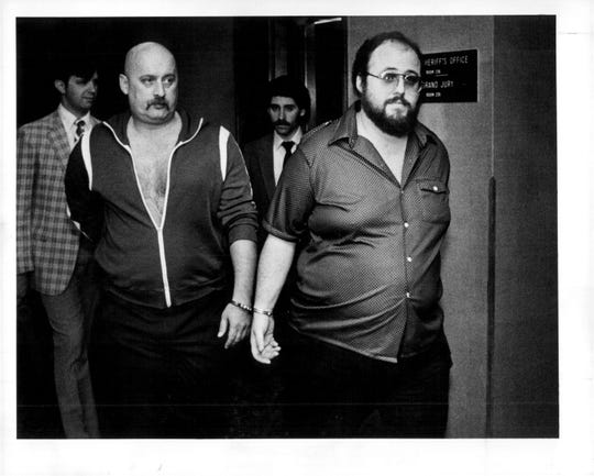 Thomas Taylor, left, and Thomas Torpey, right, as they enter court for a bail hearing in 1982. Taylor and Torpey were eventually convicted of second-degree murder in 1985 in the slaying of John Fiorino.