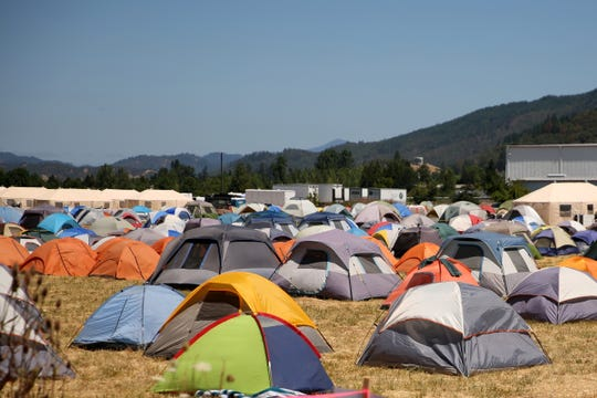 Hundreds of tents for firefighters fill a camp for the Milepost 97 Fire near Canyonville in southern Oregon on July 30, 2019.