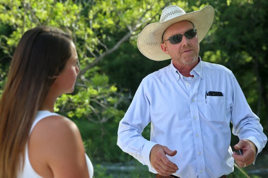 Morgan and Brian Treadwell discuss the amenities at their new wedding venue on the banks of the South Concho River near Christoval on Tuesday, July 30, 2019.