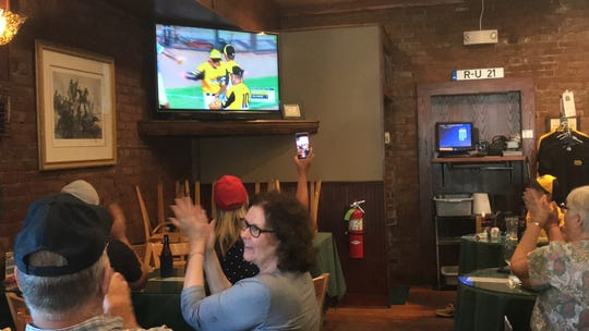 Fans at the Blarney Stone Pub in Onancock, Virginia watch the Central Accomack Little League play in the team's second game in the Senior League Baseball World Series on Monday, July 29, 2019. The team won 6-1 over Delaware.
