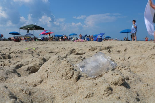 A plastic bag lies discarded on the Ocean City, Maryland, beachfront Monday, July 29, 2019. The town of Ocean City initiated a program this month to incentivize businesses to hand out less disposable plastic. (Julia Rentsch  / Salisbury Daily Times)