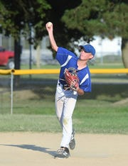 A Fruitland Little League ballplayer throws to first on Monday, July 29, 2019.