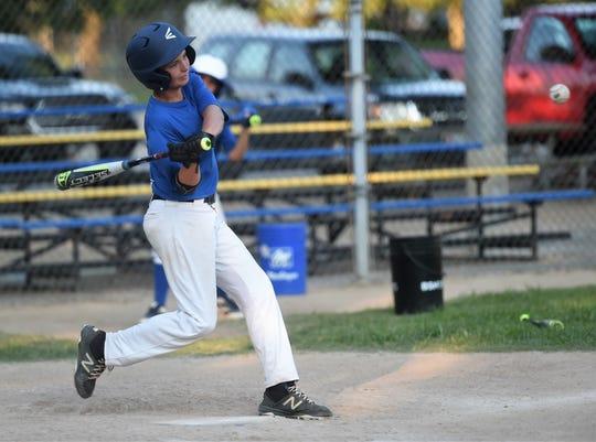 Fruitland Little League ballplayer Trevin Whitelock takes a swing on Monday, July 29, 2019.