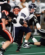 West Central's Brent Schmeichel bursts through the Sisseton line for one of his two touchdowns in the 1997 state championship game. Schmeichel rushed for 68 yards on 12 carries as the Trojans won.