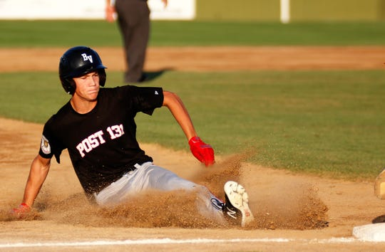 Brandon Valley's Michael Chevalier slides into third base against Renner in the Class A Legion semi-final game on Monday, July 29, 2019 in Mitchell.