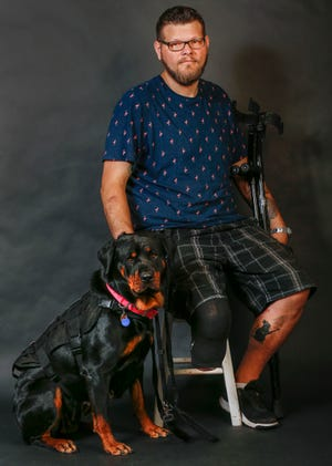 Cole Goodwin and his service dog, Stella.
