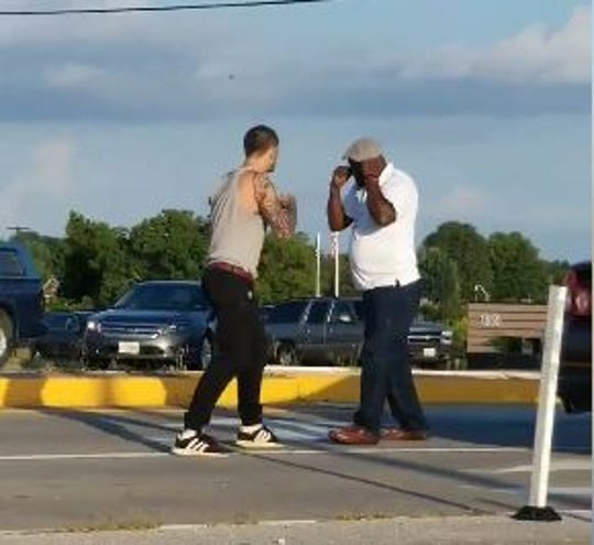 A still frame from a video shot by a passerby shows two men preparing to fight on Kansas Expressway in Springfield.