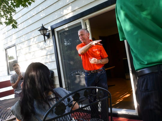 """St. Cloud mayor Dave Kleis greets guests during a """"Dinner With Strangers"""" event at his home Tuesday, July 23, 2019, in St. Cloud."""