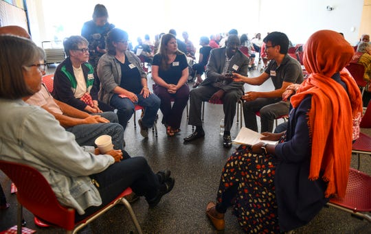 People gather for conversation during a Dine and Dialogue event Saturday, July 20, 2019, at the St. Cloud Public Library.