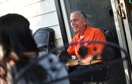 St. Cloud mayor Dave Kleis smiles while talking with dinner guests at his home Tuesday, July 23, 2019, in St. Cloud.