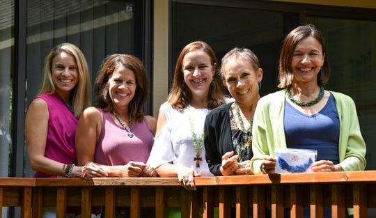 Five sisters have plans to carry on the legacy of Necklaces of Love, a charity project of their late mother, Betty Kampa Miller. Pictured are, from left to right; Lori Kampa Kearney, Mary Plankers, Lisa McKeown, Sue Meyer and Kathy Kampa Vilina.