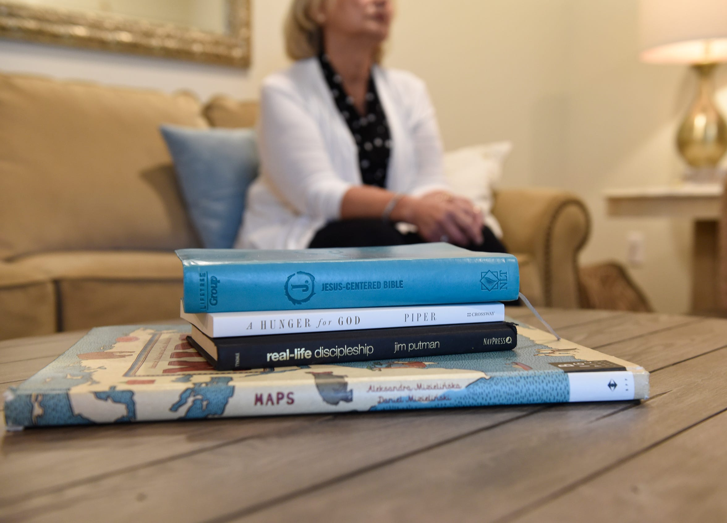 Books in Samantha Grimsley's home provide examples of why she feels it's her mission to love her neighbors, Wednesday, July 17, 2019.