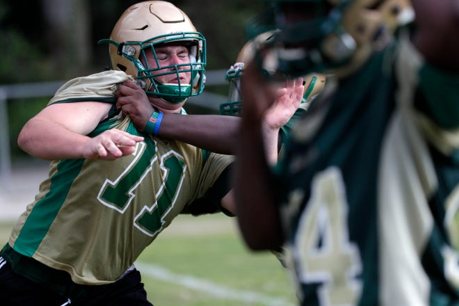 The Lincoln High School football team holds one their first fall practices Tuesday, July 30, 2019.