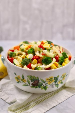 Summer Pasta Salad is loaded with squash, broccoli and tomatoes.