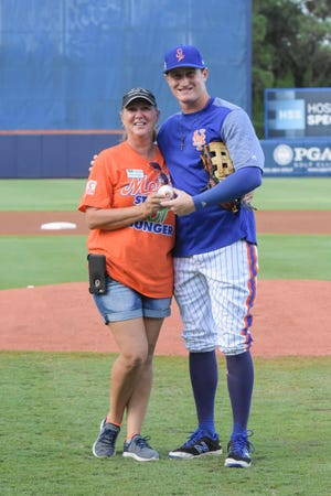 Ian Strom of the St. Lucie Mets delivers the ball to Casey Corbett for the ceremonial first pitch in 2018.