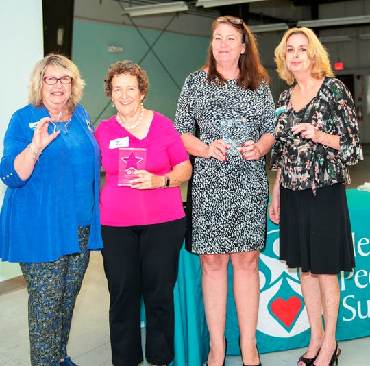 Helping People Succeed President/CEO Suzy Hutcheson, left, Bliss Browne, Beth Prinz Lowy and Glenna Parris at the nonprofit's annual meeting in Jensen Beach.