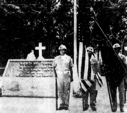"An American Legion color guard stands before the granite ""Lest We Forget"" monument and flag staff May 10, 1964, at Veterans Memorial Island Sanctuary. Color guards from all of Indian River County's veterans organizations took part in dedicating the sanctuary that day. Hundreds of local residents attended, according to Press Journal archives.."