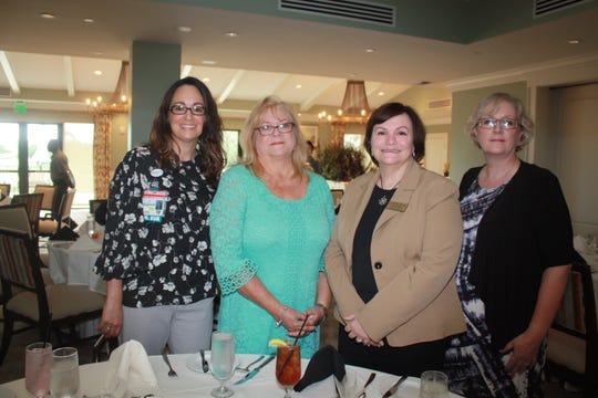 Kathlyn McGlynn, left, Lou Allinghame, Valerie Bell and Nicky Smith at the Martin County Healthy Start Coalition luncheon at Pipers Landing Country Club in Palm City.