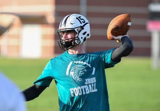 Jensen Beach High School quarterback Dylan Duchene throws a pass during practice on July 30, 2019.