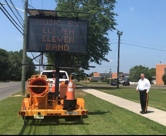 Garden State Highway Products donates the use of electronic signs to help Vineland Police spread the word about National Night Out festivities set for Aug. 6, 2019. Capt. Dave Cardana, pictured at right, is one of organizers.