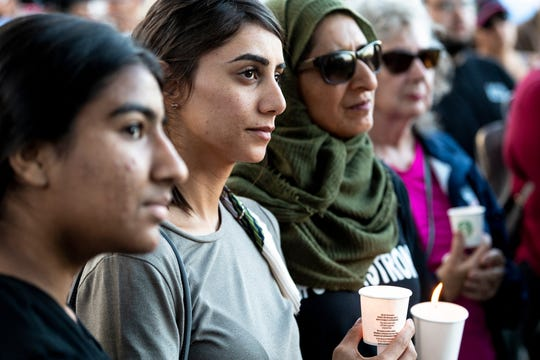 Zara Hassan, left, Hina Moheyuddin and Noshaba Afzal gather with other community members Monday, July 29, 2019 next to Gilroy's library to honor victims of Sunday's shooting at the Gilroy Garlic Festival.