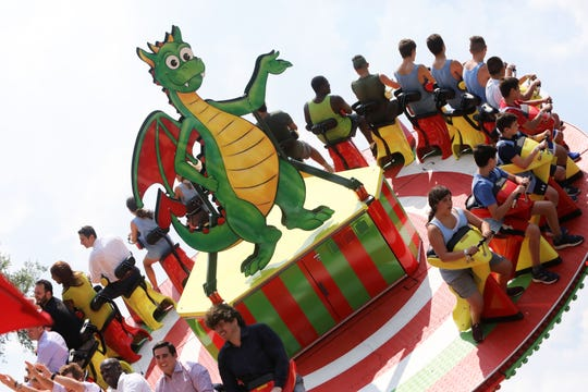 "Campers and officials try out the new ride at Playland called ""Dragonator"" during the official opening July 30, 2019 in Rye."
