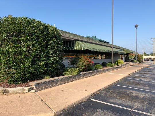 The parking lot at Crossroads Restaurant on Kirkwood Highway was mostly empty Tuesday evening. The restaurant's marquee says it plans to reopen Wednesday after a weeklong closure.