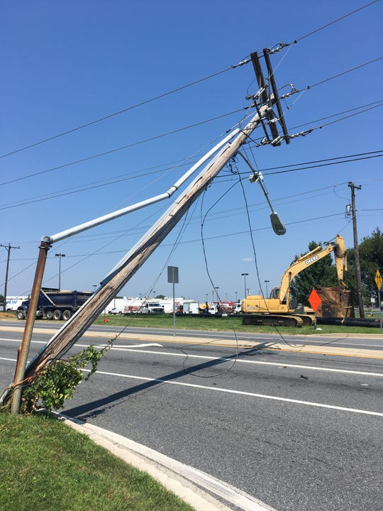 A tractor-trailer hit low-hanging wires at Del. 273 and Quigley Boulevard near New Castle on Tuesday.